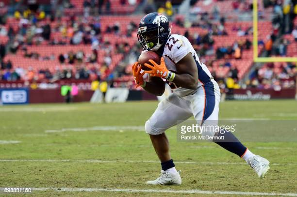 Running back CJ Anderson of the Denver Broncos scores a twopoint conversion in the fourth quarter against the Washington Redskins at FedExField on...