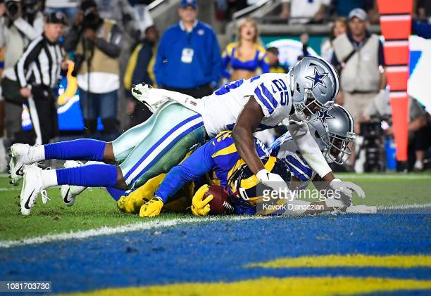 Running back C.J. Anderson of the Los Angeles Rams is stopped at the 1-yard line by free safety Xavier Woods of the Dallas Cowboys in the second...
