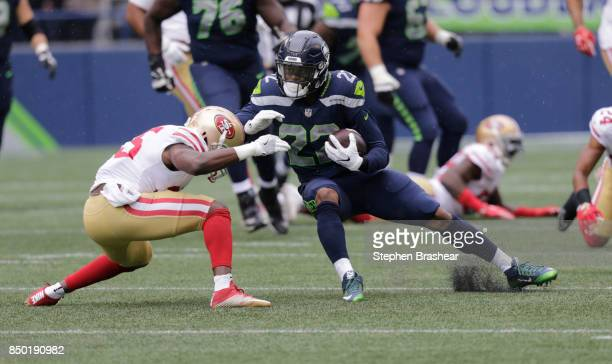 Running back CJ Prosise of the Seattle Seahawks runs with the ball as defensive back Jimmie Ward of the San Francisco 49ers moves in to make a tackle...