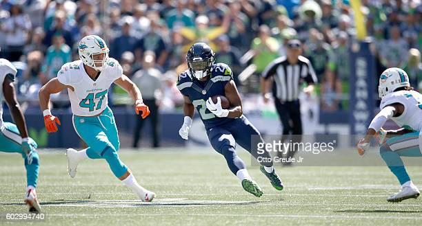 Running back CJ Prosise of the Seattle Seahawks rushes against the Miami Dolphins in the first half at CenturyLink Field on September 11 2016 in...