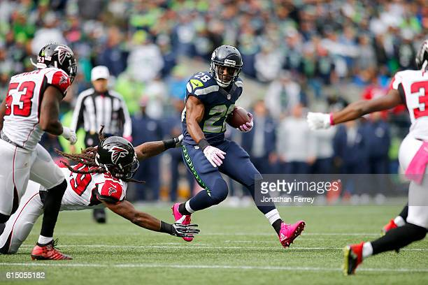 Running back C.J. Spiller of the Seattle Seahawks tries to break free from defensive end Adrian Clayborn of the Atlanta Falcons at CenturyLink Field...