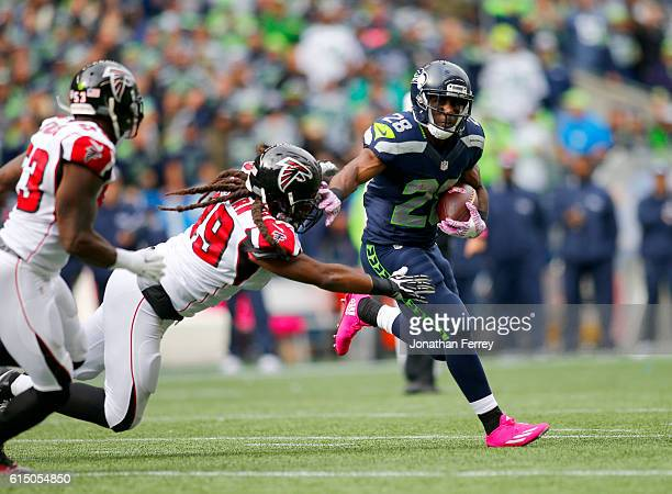 Running back C.J. Spiller of the Seattle Seahawks tries to go around defensive end Adrian Clayborn of the Atlanta Falcons at CenturyLink Field on...
