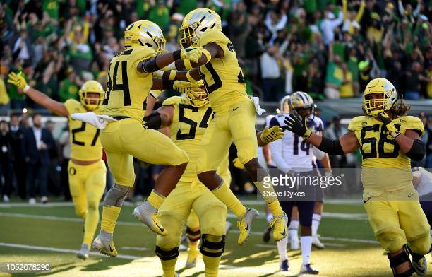 Running back CJ Verdell of the Oregon Ducks celebrates with teammates after scoring the winning touchdown in overtime of the game against the...