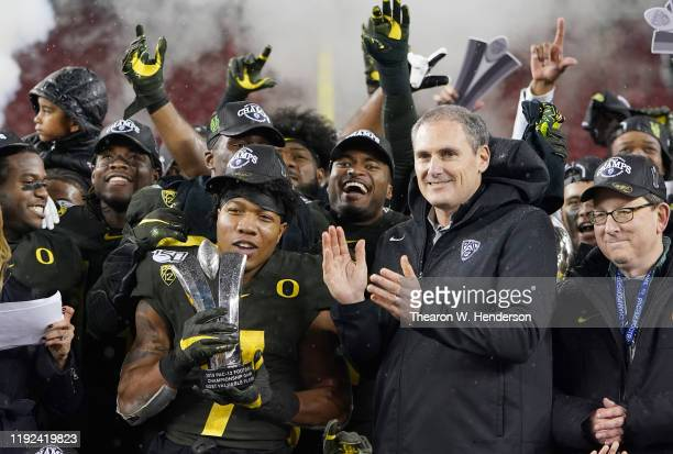 Running back CJ Verdell of the Oregon Ducks is presented with the MVP trophy after the Ducks defeated the Utah Utes 3715 in the Pac12 Championship...