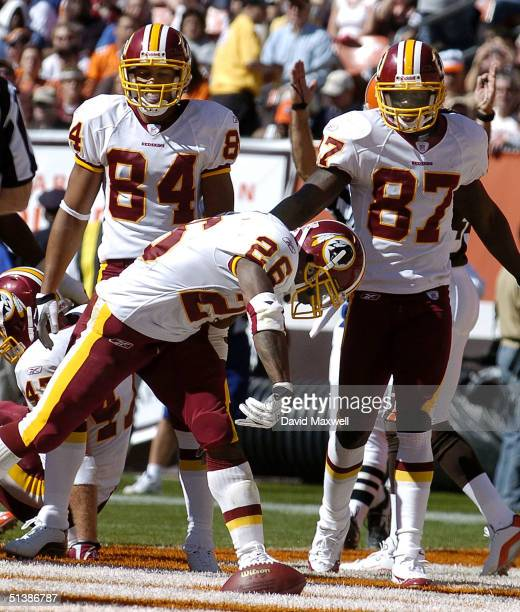 Running back Clinton Portis of the Washington Redskins celebrates a touchdown against the Cleveland Browns as teammates Taylor Jacobs and Rod Gardner...