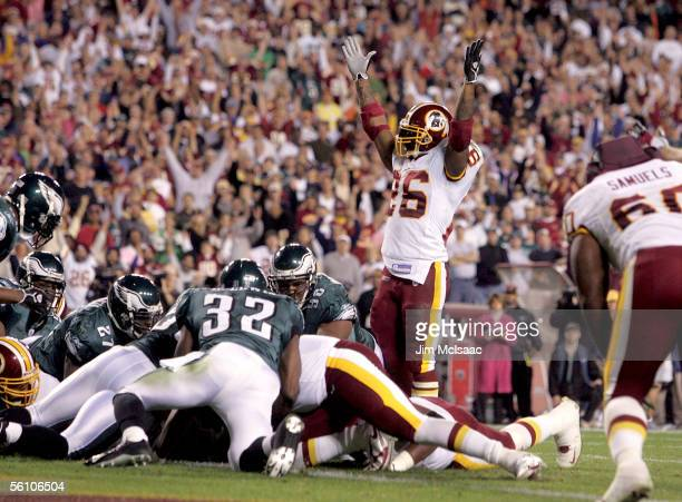 Running back Clinton Portis of the Washington Redskins celebrates his team's first touchdown against the Philadelphia Eagles on November 6 2005 at...