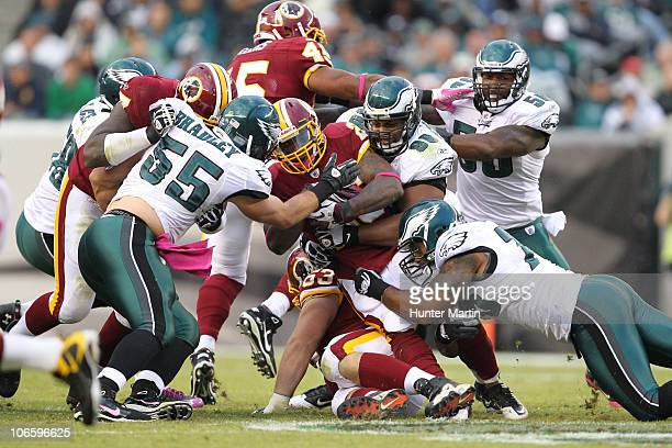 Running back Clinton Portis of the Washington Redskins is tackled by linebacker Stewart Bradley and defensive tackle Mike Patterson of the...