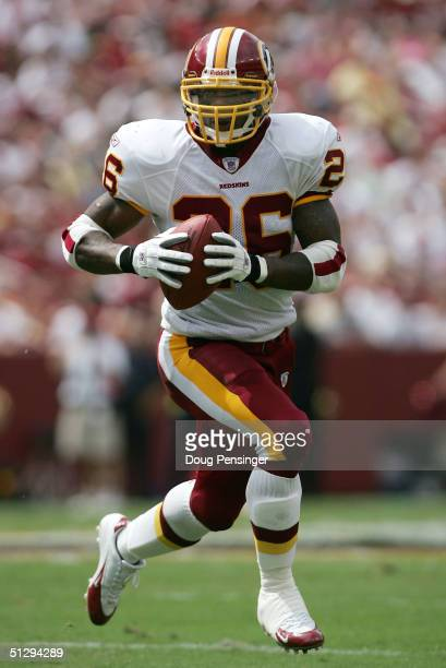 Running back Clinton Portis of the Washington Redskins picks up yardage against the Tampa Bay Buccaneers on September 12 2004 at FedEx Field in...