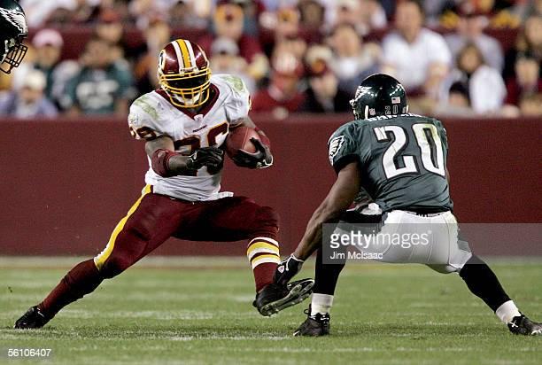 Running back Clinton Portis of the Washington Redskins runs against free safety Brian Dawkins of the Philadelphia Eagles on November 6 2005 at FedEx...