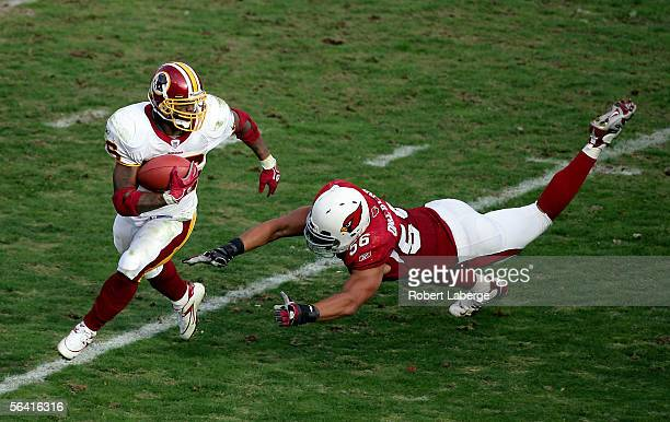 Running back Clinton Portis of the Washington Redskins runs around defensive end Chike Okeafor of the Arizona Cardinals during the first half of the...