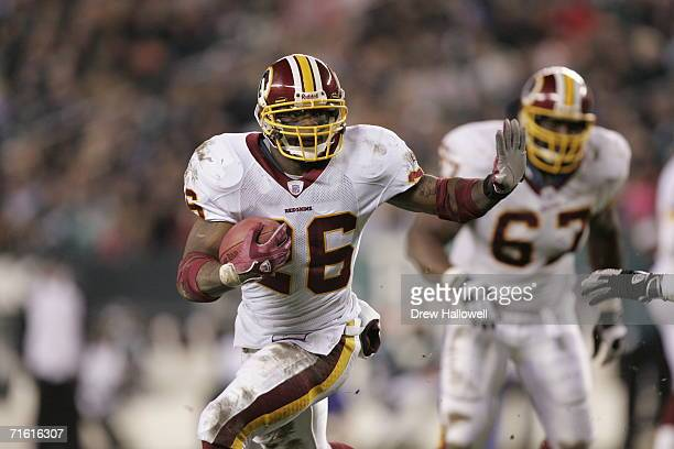Running back Clinton Portis of the Washington Redskins runs with the ball during the game against the Philadelphia Eagles on January 1, 2006 at...
