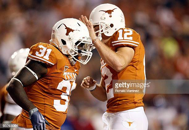 Running back Cody Johnson of the Texas Longhorns celebrates a touchdown with Colt McCoy against the Kansas Jayhawks at Darrell K RoyalTexas Memorial...
