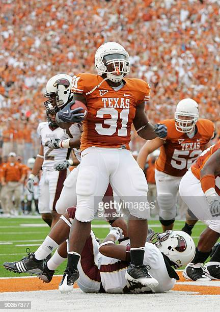 Running back Cody Johnson of the Texas Longhorns celebrates after scoring his first touchdown against of the Louisiana Monroe Warhawks in the first...