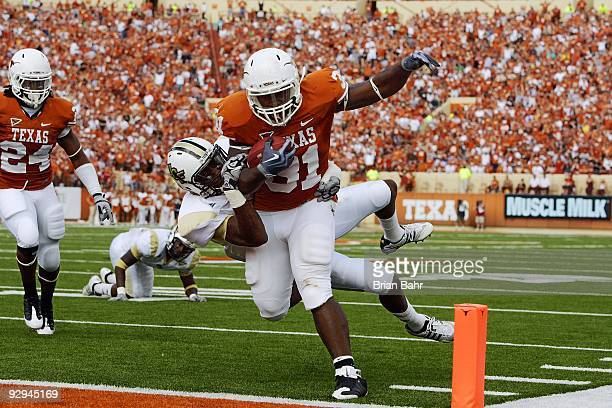 Running back Cody Johnson of the Texas Longhorns scores his second touchdown against the UCF Knights a third down 13yard run on November 7 2009 at...