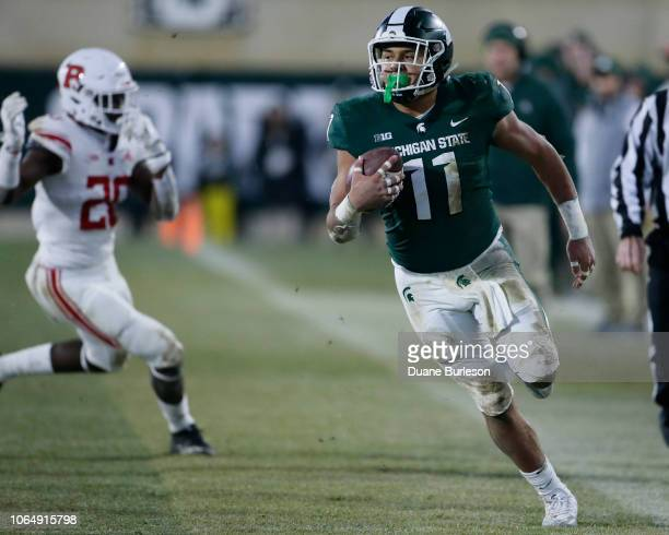 Running back Connor Heyward of the Michigan State Spartans carries the ball against the Rutgers Scarlet Knights during during the first half at...