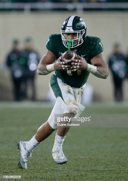 Running back Connor Heyward of the Michigan State Spartans carries against the Rutgers Scarlet Knights during the first half at Spartan Stadium on...