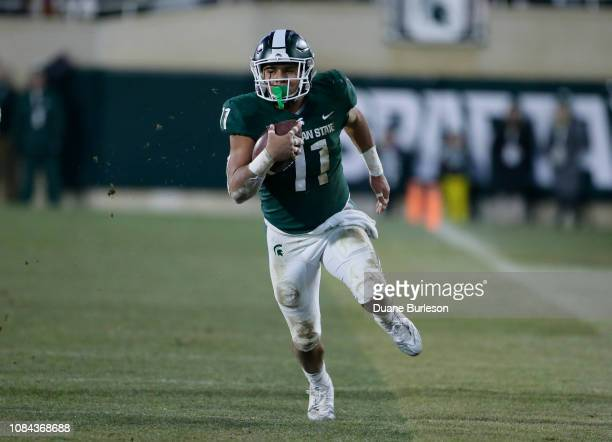 Running back Connor Heyward of the Michigan State Spartans carries the ball against the Rutgers Scarlet Knights during the first half at Spartan...