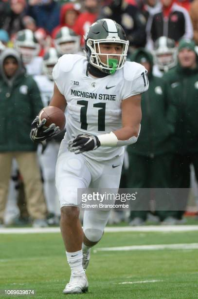 Running back Connor Heyward of the Michigan State Spartans runs against the Nebraska Cornhuskers at Memorial Stadium on November 17 2018 in Lincoln...