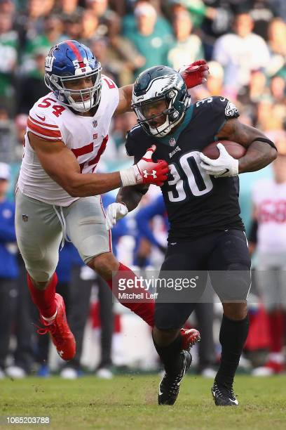 Running back Corey Clement of the Philadelphia Eagles carries the ball against outside linebacker Olivier Vernon of the New York Giants during the...