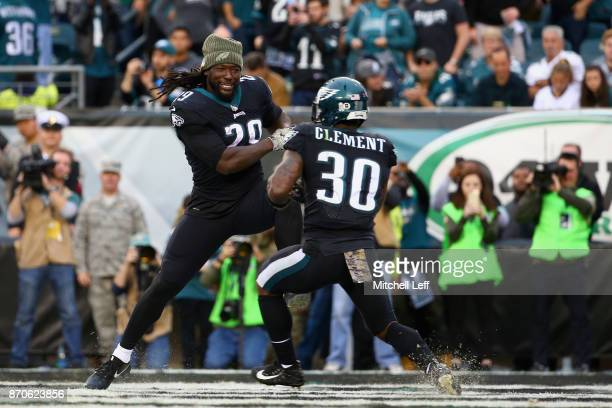Running back Corey Clement of the Philadelphia Eagles celebrates his touchdown with teammate running back LeGarrette Blount during the fourth quarter...