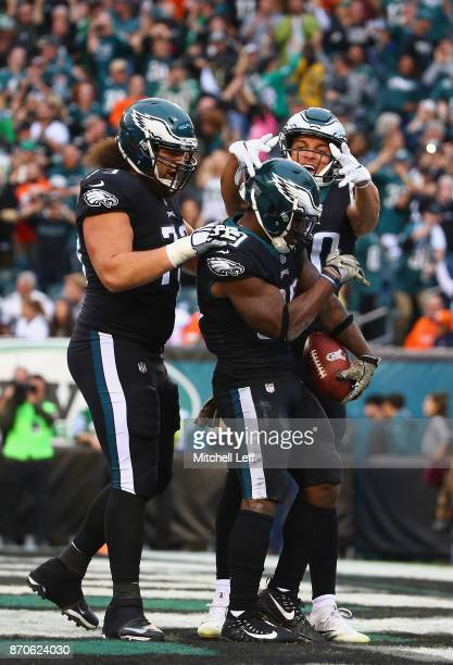 Running back Corey Clement of the Philadelphia Eagles celebrates his touchdown with teammates during the fourth quarter against the Denver Broncos at...