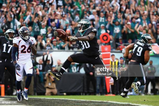 Running back Corey Clement of the Philadelphia Eagles leaps into the endzone to score a touchdown against the Denver Broncos during the first quarter...