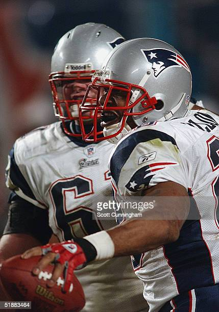 Running Back Corey Dillon of the New England Patriots celebrates a score with Guard Stephen Neal in a game against the Miami Dolphins on December 20...