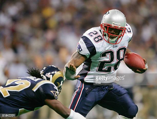 Running back Corey Dillon of the New England Patriots runs upfield against the St Louis Rams on November 7 2004 at the Edward Jones Dome in St Louis...