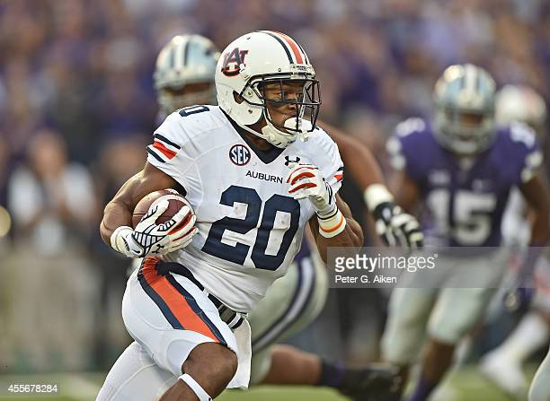 Running back Corey Grant of the Auburn Tigers rushes up field against the Kansas State Wildcats during the first half on September 18 2014 at Bill...