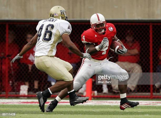 Running back Corey Ross of the Nebraska Cornhuskers dodges Sam Bryant of the Pittsburgh Panthers on September 17, 2005 at Memorial Stadium in...