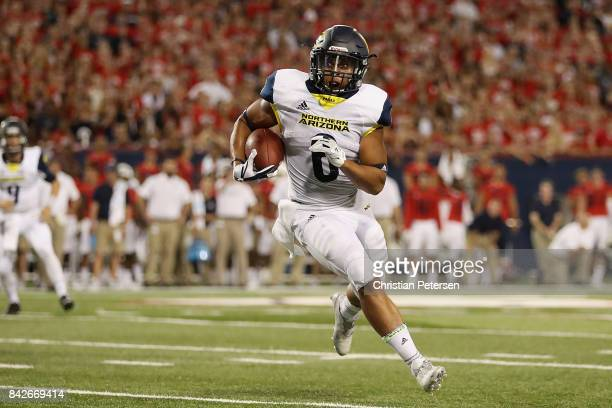 Running back Cory Young of the Northern Arizona Lumberjacks scores on a seven yard rushing touchdown against the Arizona Wildcats during the first...