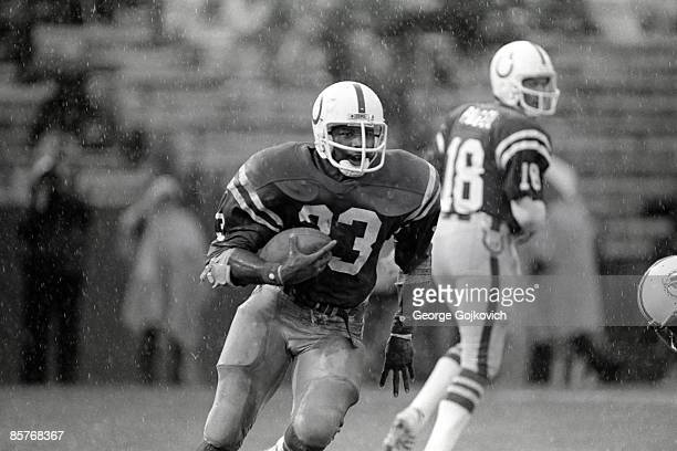 Running back Curtis Dickey of the Baltimore Colts runs the football after taking a handoff from quarterback Mike Pagel during a game against the...