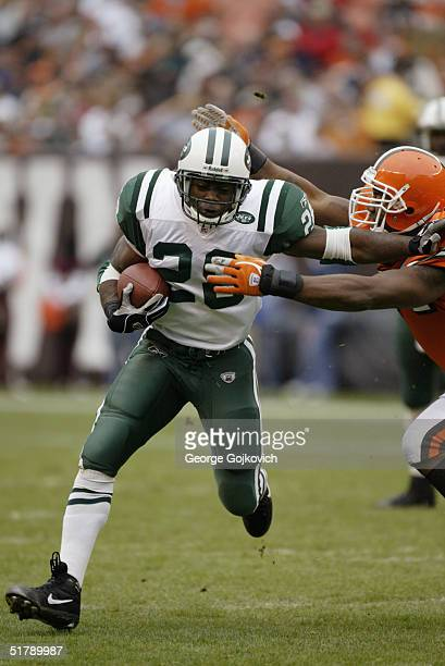 Running back Curtis Martin of the New York Jets is grabbed by linebacker Andra Davis of the Cleveland Browns at Cleveland Browns Stadium on November...