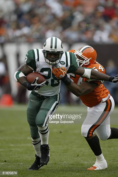 Running back Curtis Martin of the New York Jets is tackled by linebacker Andra Davis of the Cleveland Browns at Cleveland Browns Stadium on November...
