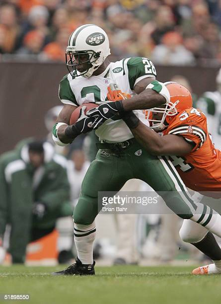 Running back Curtis Martin of the New York Jets runs upfield against linebacker Andra Davis of the Cleveland Browns on November 21 2004 at Cleveland...