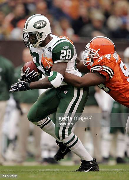 Running back Curtis Martin of the New York Jets takes linebacker Andra Davis the Cleveland Browns for a ride in the first quarter on November 21 2004...