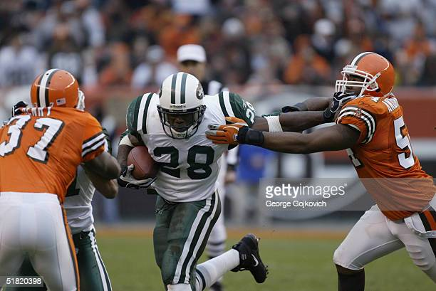 Running back Curtis Martin of the New York Jets tries to get past linebacker Andra Davis of the Cleveland Browns at Cleveland Browns Stadium on...
