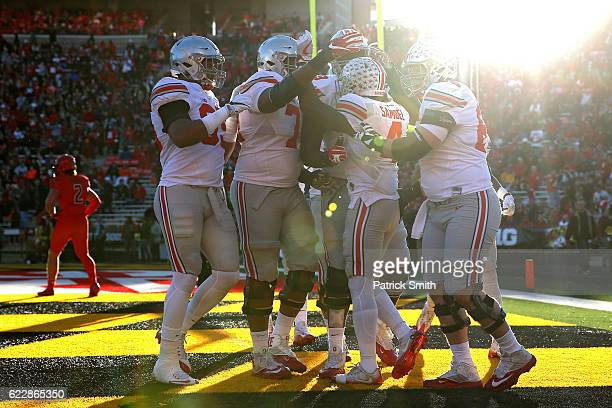 Running back Curtis Samuel of the Ohio State Buckeyes celebrates with teammates after scoring a touchdown against the Maryland Terrapins in the first...