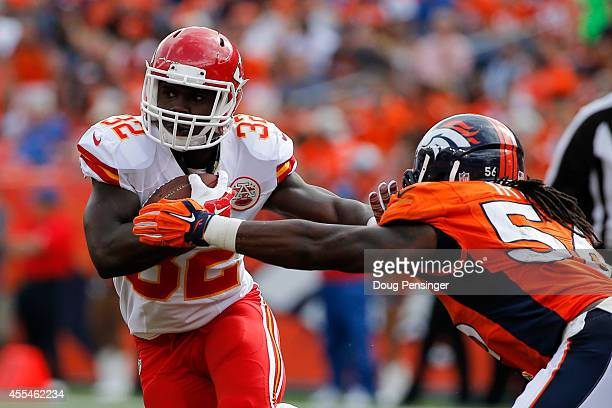 Running back Cyrus Gray of the Kansas City Chiefs works to break a tackle attempt by outside linebacker Danny Trevathan of the Denver Broncos during...