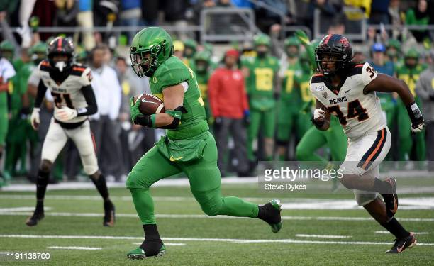 Running back Cyrus HabibiLikio of the Oregon Ducks runs for a touchdown during the second half of the game against the Oregon State Beavers at Autzen...