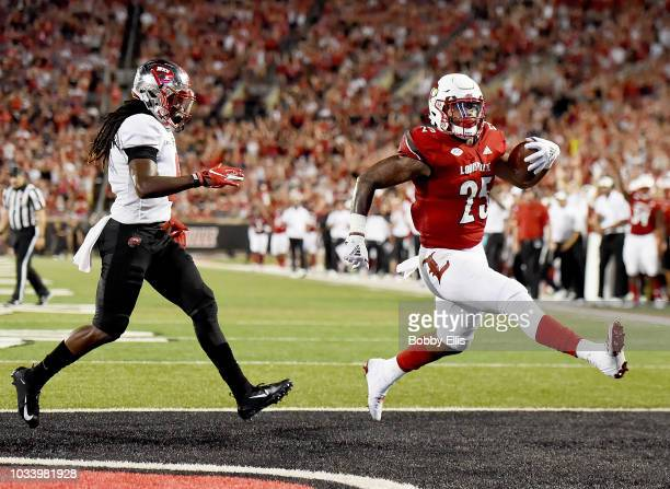 Running back Dae Williams of the Louisville Cardinals runs for a touchdown during the fourth quarter of the game against the Western Kentucky...
