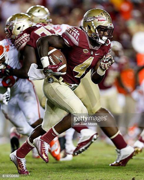 Running back Dalvin Cook of the Florida State Seminoles on a running play during the game against the Clemson Tigers at Doak Campbell Stadium on...