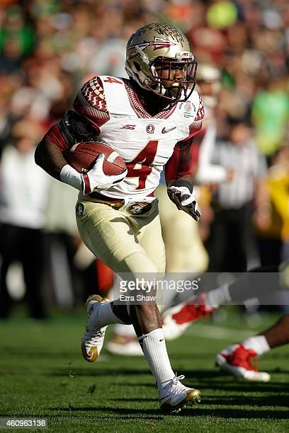 Running back Dalvin Cook of the Florida State Seminoles runs with the ball against the Oregon Ducks during the College Football Playoff Semifinal at...