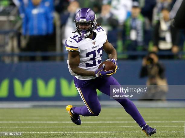 Running back Dalvin Cook of the Minnesota Vikings carries the ball against the defense oat CenturyLink Field on December 02, 2019 in Seattle,...