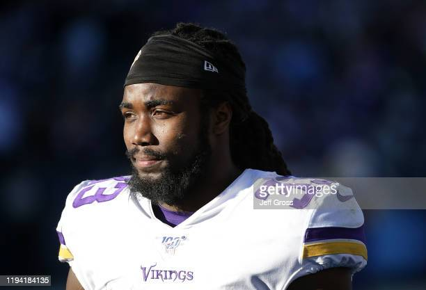 Running back Dalvin Cook of the Minnesota Vikings looks on from the bench after coming out of the game in the second half against the Los Angeles...