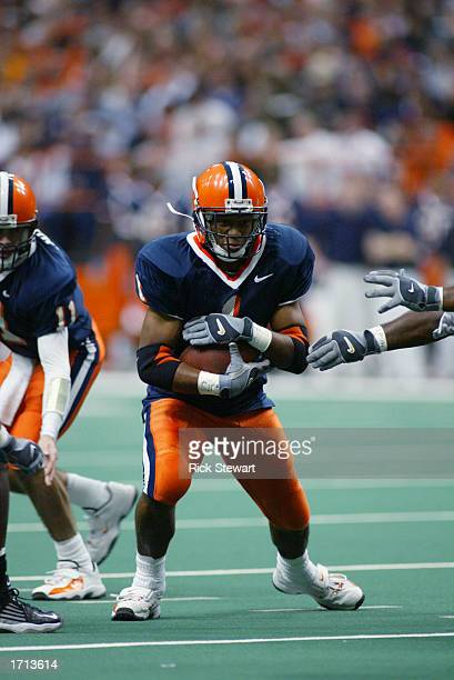 Running back Damien Rhodes of Syracuse University runs for yards during the game against the University of Miami at the Carrier Dome on November 30...