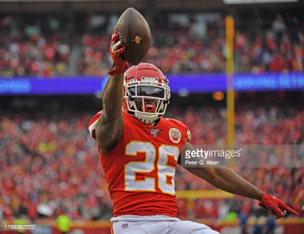 Running back Damien Williams of the Kansas City Chiefs celebrates after scoring a touchdown in the first half during the AFC Divisional playoff game...