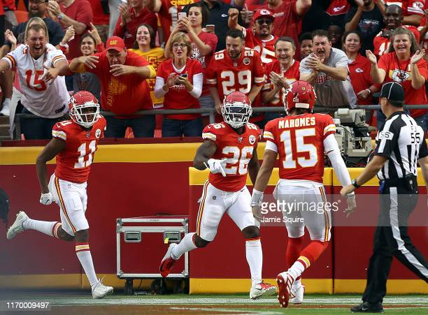 Running back Damien Williams of the Kansas City Chiefs celebrates with quarterback Patrick Mahomes after a touchdown during the 1st quarter of the...