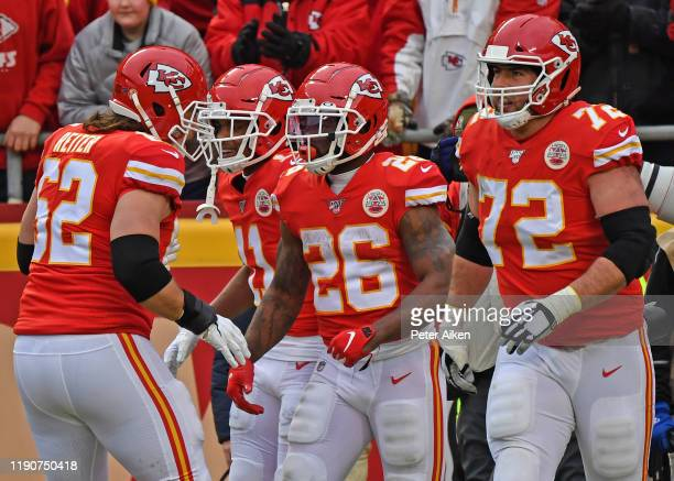 Running back Damien Williams of the Kansas City Chiefs celebrates with his teammates after scoring a touchdown against the Los Angeles Chargers...