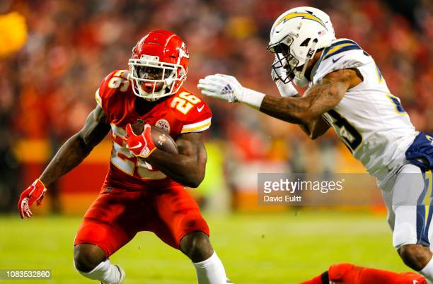 Running back Damien Williams of the Kansas City Chiefs evades free safety Derwin James of the Los Angeles Chargers at Arrowhead Stadium on December...